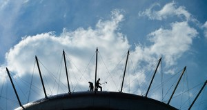 Painters work Sept. 15 on top of the water tank in Delano Park in Decatur, Alabama. The U.S. government reported Friday that employers cut back on hiring in September. (AP Photo: Gary Cosby Jr./The Decatur Daily)