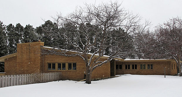Snow falls on the North Dakota governor's residence in February 2013 in Bismarck, North Dakota. The design for a new residence on the grounds would allow the governor and first lady to remain on site during construction. (AP file photo)