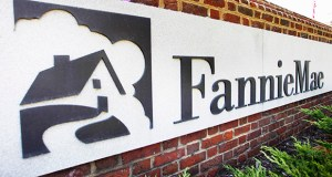 This August 2011 photo shows the front of the Fannie Mae headquarters in Washington. The mortgage giant reported Thursday net income of $2 billion from July through September, 2015 down from $3.9 billion a year earlier. AP file photo
