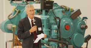 St. Paul Port Authority President Louis Jambois, who plans to retire in February, speaks in October at an open house for Moventas, a Finnish wind turbine servicer the agency recruited to a revamped industrial space on St. Paul's east side. Staff photo: Bill Klotz