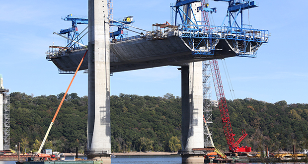 Workers install the second set of stay cables Oct. 8 at Pier 8 for the St. Croix Crossing, which is under construction between Oak Park Heights, Minnesota, and St. Joseph, Wisconsin. The U.S. House has voted to continue transportation programs like the one that helped fund St. Croix Crossing for six years with no significant increase in spending. File photo: Bill Klotz