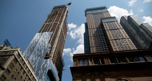 The most expensive closed sale of an apartment in New York City, the $100.5 million purchase of a penthouse atop Extell Development Co.'s One57, shown here under construction in July 2012, was to a buyer known only as P89-90 LLC. Bloomberg file photo