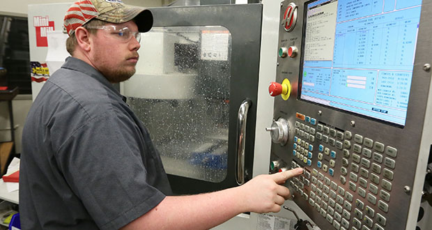 Dunwoody College of Technology student Joe Lerum uses an automated milling machine Feb. 19 in the college's milling center. Creighton economist Ernie Goss has predicted slow-and-steady manufacturing job gains in the coming months. File photo: Bill Klotz