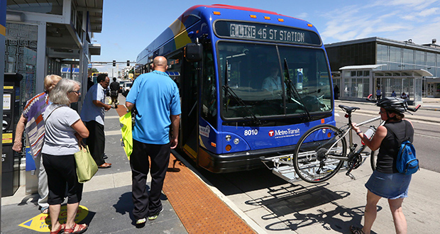 A new A Line rapid transit bus picks up passengers at a station at Snelling and University avenues in St. Paul. In its first week of operation, the A Line helped to draw nearly 10,000 more rides in the corridor between Rosedale Center in Roseville and the 46th Street Station in Minneapolis than the route usually attracts. (Staff photo: Bill Klotz)