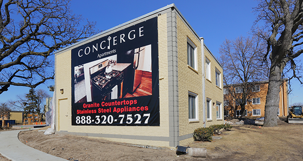 A sign photographed in February advertises the amenities at the renovated Concierge Apartments (formerly Crossroads at Penn) at 7600 Penn Ave. S. in Richfield. (File photo: Bill Klotz)