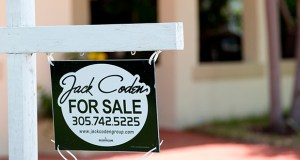 This July 19 photo shows a sign announcing a home is for sale and under contract in Surfside, Florida. (AP Photo: Wilfredo Lee)