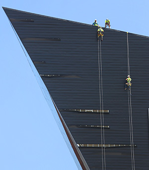 Workers on Wednesday start repairs on 10 to 12 exterior zinc panels that came loose on the new U.S. Bank Stadium in Minneapolis during Tuesday's storms. (Staff photo: Bill Klotz)