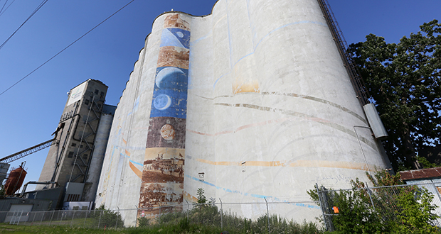 A nearly 90-year-old grain elevator at 3333 41st St. E in Minneapolis may soon be home to 33 storage units. A rezoning request to allow for industrial uses on the 0.78-acre lot was approved by the city's Planning Commission on Monday night and will be heard by the City Council next month. (Staff photo: Bill Klotz)