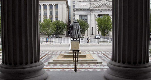 A statue of the Albert Gallatin, the fourth secretary of the U.S. Treasury Department, stands Aug. 17, 2010, on the north patio of the US Treasury Building in Washington. (AP file photo)