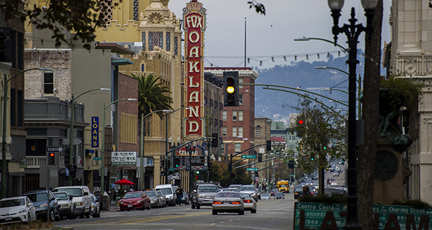 Cars drive along Telegraph Avenue Nov. 18, 2014, in Oakland, California. The San Francisco real estate boom has reached across the bay to once-affordable Oakland. (Bloomberg file photo)