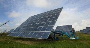 """Smaller """"solar gardens"""" are popping up in communities as an alternative to rooftop solar panels large solar farms spread across hundreds or thousands of acres. (Bloomberg file photo)"""