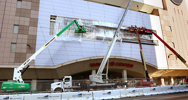 Workers cover a large hole with plastic sheeting on the east side of Target Center over First Avenue North. The building's $129 million renovation is nearing its first big milestone. (Staff photo: Bill Klotz)