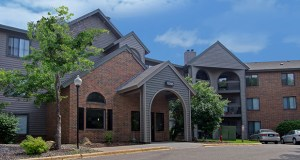 The 252-unit Woodlands of Minnetonka apartment complex, at 10275 Greenbrier Road, near Highway 169 and Cedar Lake Road, was built in 1988. (Submitted photo: CBRE)
