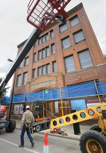 The four-story brick Maytag building is getting a $13 million rehab to make room for offices, a first-floor restaurant and a lower-level bar. (Staff photo: Bill Klotz)