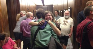 "Gretchen Vanderlinden-Wang and Aaron Sinner hug after the St. Paul City Council gave final approval to the city's ""earned sick and safe time"" ordinance Wednesday. (Staff photo: Matt M. Johnson)"