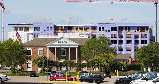 Solomon Real Estate Group is partnering with TCF Financial Corp. to redevelop the bank branch site at 1801 Plymouth Road in Minnetonka, immediately west of Ridgedale Center. Across the street, a Highland Bank site is being redeveloped into a six-story mixed-use apartment project where the bank will have a new branch. (Staff photo: Bill Klotz)
