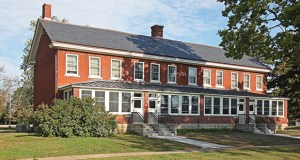 Five buildings were renovated into housing for homeless veterans and their families, including this former officers' quarters. (Submitted photo)