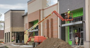 The new Central Park Commons shopping center in Eagan, shown under construction this summer, offers several retailers new to the Twin Cities market including Hy-Vee, Sierra Trading Post and Total Wine. (File photo: Bill Klotz)