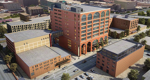 Designs for the Swervo/CPM 10-story office project show a red brick veneer building with large arched windows and first-floor retail. The glass skyway would connect to the Internet Exchange Building. (Submitted rendering: DJR)