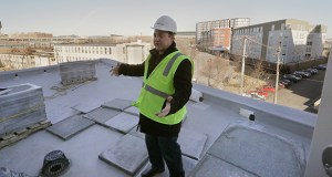 Daniel Oberpriller, co-principal of CPM Cos., stands on one of the outdoor patios that some rooms will have at the new DoubleTree by Hilton hotel at 501 Huron Blvd. in Minneapolis. (Staff photo: Bill Klotz)