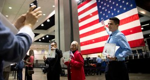Erik Danialian, a 21-year-old immigrant from Iran, poses with his U.S citizenship certificate in front of a large U.S. flag after a naturalization ceremony Feb. 15 at the Los Angeles Convention Center in Los Angeles. The U.S. economy will need immigrant workers in order to increase growth, according to Neel Kashkari, president and CEO of the Federal Reserve Bank of Minneapolis. (AP file photo)