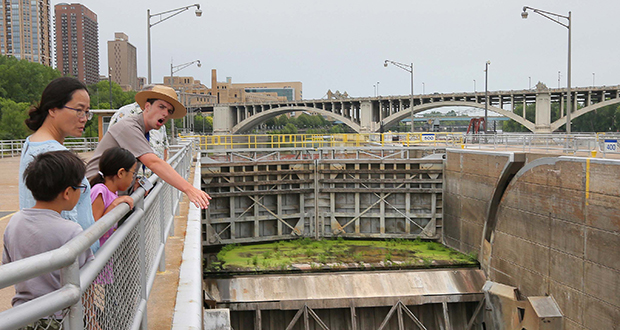 National Park Service Ranger Forest Eidbo leads a tour group at the St. Anthony Falls Upper Lock and Dam. A plan to turn the facility into a recreational destination was discussed at Minneapolis Downtown Council's 2025 Plan Quarterly Forum on Tuesday. (Staff photo: Bill Klotz)
