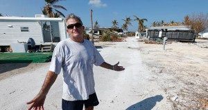 Richard Lessig, a longtime resident at the Sunshine Key RV Resort and Marina, gestures during a Sept. 21, 2017 interview next to his trailer in Big Pine Key, Florida. Monroe County is asking mobile home park owners to allow FEMA to set up temporary housing on their properties. (AP Photo: Wilfredo Lee)