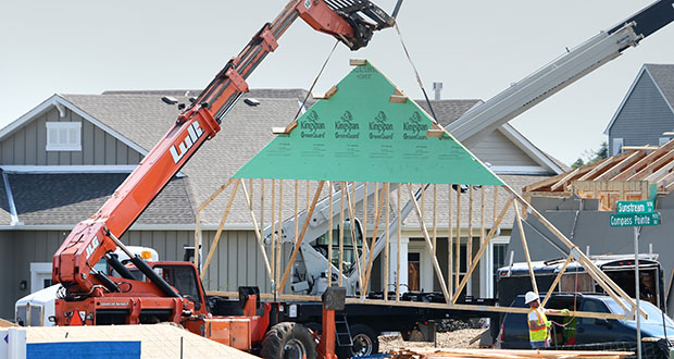 In this Aug. 30 photo, carpenters install roof trusses in a CalAtlantic Homes development in Woodbury. A new survey shows Twin Cities area homebuilders are more upbeat than they were six months ago when it comes to future housing starts. (Staff photo: Bill Klotz)