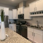 Units have granite countertops, custom kitchen islands and stainless steel appliances.