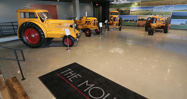 The Moline's lobby features a veritable tractor museum, a nod to Hopkins' history with the Minneapolis-Moline Power Equipment Co., which operated near the apartment site until 1963. (Staff photo: Bill Klotz)
