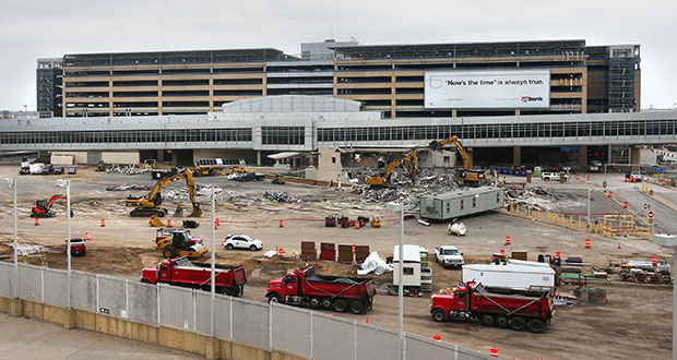 Site work is underway for the $240 million Silver Ramp at the Minneapolis-St. Paul International Airport's Terminal 1. The 5,000-space parking ramp will rise on a constrained site between the existing Blue and Red ramps, the airport post office, and roadways leading to and from the terminal. (Staff photo: Bill Klotz)