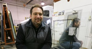 Mark Meyer is the new co-owner of Artic Glass, a commercial-glass business at 10068 Flanders Court NE in Blaine. He and fiancee Deanna Morris purchased the business with a loan from Anchor Bank that was guaranteed by the U.S. Small Business Administration through its District Office in Minnesota. (Staff photo: Bill Klotz)