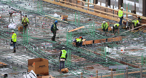 Private construction spending increased by 1 percent to an all-time high in November, the Commerce Department said Wednesday. This photo shows a construction crew working Dec. 18 on the Ironclad MPLS mixed-use development at 811 S. Washington Ave. in Minneapolis. (File photo: Bill Klotz)