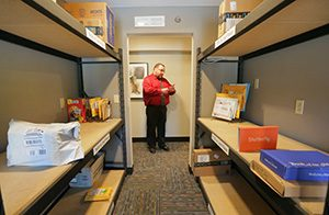 At The Concierge apartments at 7620 Penn Ave. S. in Richfield, owner Jim Soderberg set aside room to store packages as well as cold storage for flowers and medicine. Resident liaison Chip Locy is shown outside the complex's large package storage room. (Staff photo: Bill Klotz)