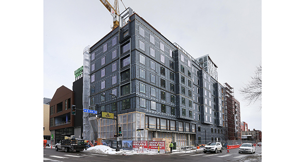 The Elliot Hotel, under construction at 523 Eighth St. S. in downtown Minneapolis, was issued permits valued at $32.6 million in 2017. Hotel and residential projects pushed Minneapolis to another big year of building permits. (Staff photo: Bill Klotz)