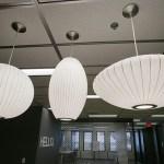 Light fixtures above an island in the 6th floor break room.