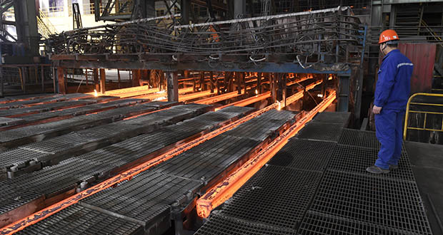 A man works March 5 at Xiwang Special Steel in Zouping County in eastern China's Shandong province. China's steel mills, a target of U.S. President Donald Trump's ire, supply half of world's output. (Photo: Chinatopix via AP)