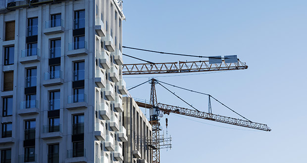 Sweden's Social Democrat-led ruling coalition is promising more property construction despite the country's recent property price slump. This photo shows cranes operating June 28, 2017, at the site of the Hagastaden urban project in Stockholm, Sweden. (Bloomberg file photo)