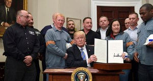 President Donald Trump holds up a proclamation on steel imports Thursday during an event in the Roosevelt Room at the White House in Washington. He also signed one for aluminum imports. (AP Photo: Susan Walsh)