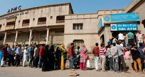An estimated 69 percent of adults had some sort of bank account in 2017, up from an estimated 51 percent in 2011 and up from 62 percent in 2014, the World Bank said Thursday. In this photo, Indians stand in a queue outside a bank to withdraw cash in December 2016 in Ahmadabad, India. (AP file photo)