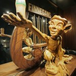 A hand-carved wooden sculpture of an Irish pixie takes center stage behind the taproom bar. (Staff photo: Bill Klotz)