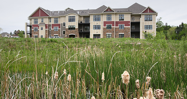 The first building in the Oakcroft condominium development at 118 Parkers Lake Road in Minnetonka could soon be joined by another condo building nearly twice its size. (Staff photo: Bill Klotz)