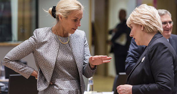 """Dutch Trade Minister Sigrid Kaag, left, talks with Ireland's Business, Enterprise and Innovation Minister Heather Humphreys during an EU foreign affairs council on trade Tuesday at the Europa building in Brussels. The EU has drawn up a list of """"rebalancing"""" duties worth $3.4 billion to impose on U.S. products if it is not permanently exempt from U.S. steel and aluminum tariffs. (AP Photo: Geert Vanden Wijngaert)"""