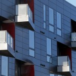 For the five-story Brunsfield North Loop, architect Julie Snow crafted a reserved, gun-metal gray panel exterior much different from the traditional brown-and-red brick exterior found in the North Loop and Warehouse District. (File photo: Bill Klotz)