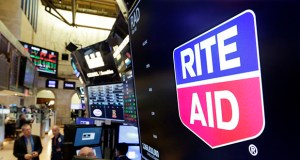 The logo for Rite Aid is displayed above a trading post Thursday on the floor of the New York Stock Exchange. Rite Aid and the grocer Albertsons called off an agreement to become a single company with the deal facing shaky prospects in a shareholder vote. (AP Photo: Richard Drew)