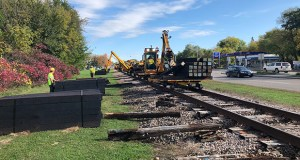 Workers repair a stretch of freight rail track near Hugo as part of a $1.5 million project. Freight rail advocates say the state needs to investment more money in such improvements. (Submitted photo)