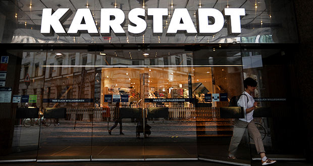 A shopper exits a Karstadt department store, operated by Signa Holding GmbH, in Hamburg, Germany, on Aug. 28. (Bloomberg photo)