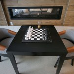 Chess can be played next to a gas fireplace in the game room.