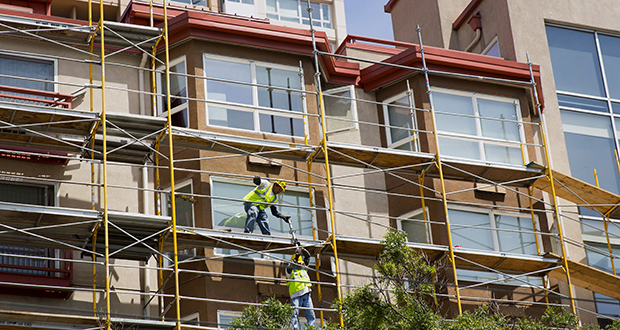 Apartment projects opening now were conceived by developers a few years ago when rent gains in the U.S. were peaking at an annual gain of 6.6 percent, according to Zillow data. This photo shows contractors at work on a new apartment building in July 2014 in downtown Seattle. (Bloomberg file photo)