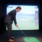 The Opus Group's Nick Murnane prepares to tee off in a golf simulator at 365 Nicollet. (Staff photo: Matt M. Johnson)